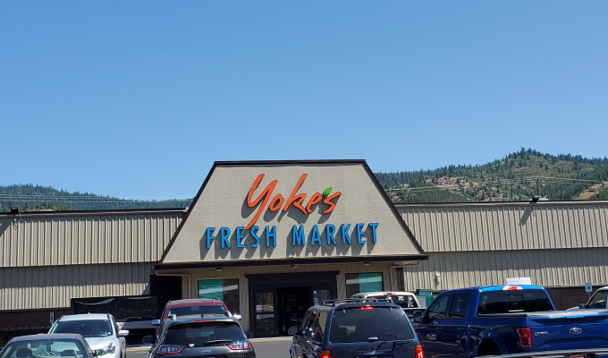 Store front picture with mountains in the background
